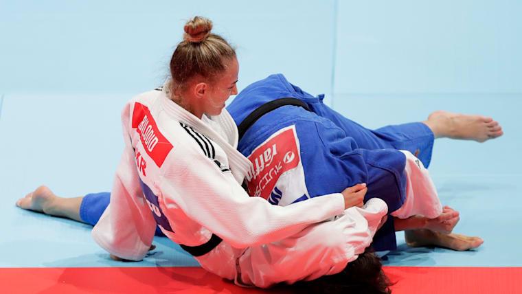 Daria Bilodid applies a tight holddown during the semifinal match against Mongolia's Urantsetseg Munkhbat.
