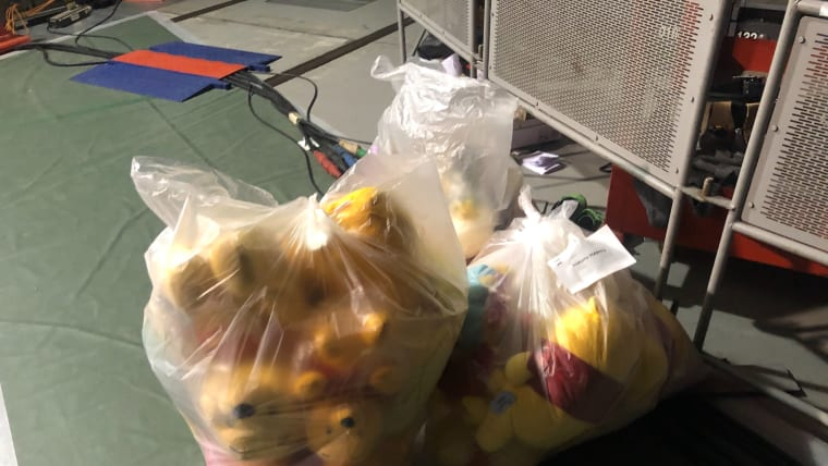 Winnie the Pooh toys are bagged up after the men's short program
