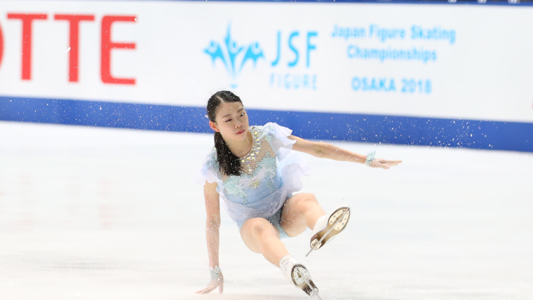 Rika Kihira falls during the short program at the Japan Figure Skating Championships