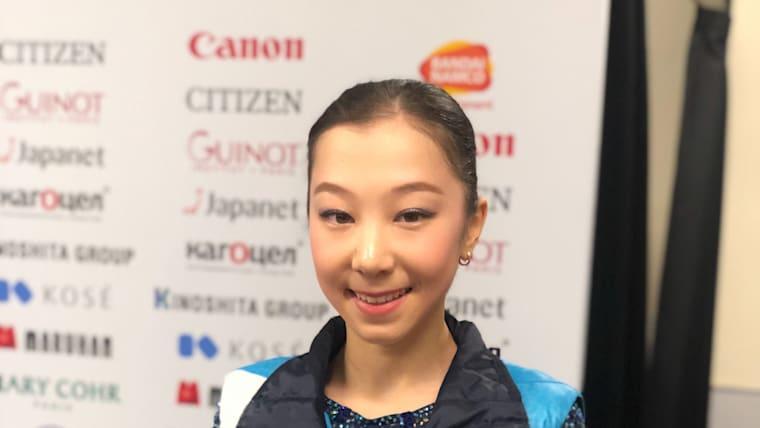 Tursynbaeva poses after her short program