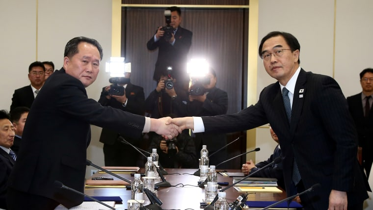 Ri Son Gwon (L), head of the North Korea delegation, shakes hands with South Korean Unification Minister Cho Myoung-gyon in Panmunjom on 9th January 2018