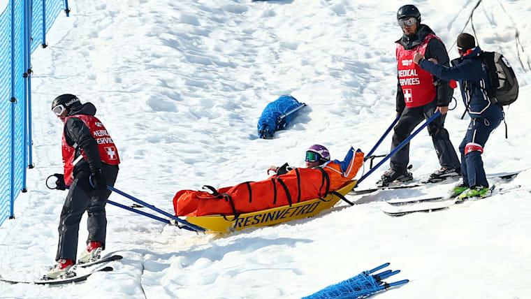 Medical service help out Moioli after crash at Sochi 2014