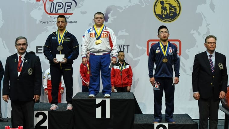 Men's -59kg podium (L-R): runner-up Franklin Leon, champion Sergey Fedosienko, third-placed Ayumi Hisatsune