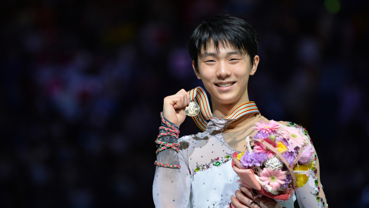 Yuzuru Hanyu poses with his 2014 ISU World Figure Skating Championships men's singles gold medal. (Photo by Atsushi Tomura/Getty Images)