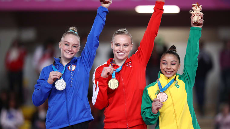 Campeones! Riley Mc Cusker of The United States, Elsabeth Black of Canada and Flavia Saraiva of Brazil stand in the podium of Women's gymnastics Individual All-Around on Day 3 of Lima 2019 Pan American Games on July 29, 2019 in Lima, Peru. (Photo by Ezra Shaw/Getty Images)