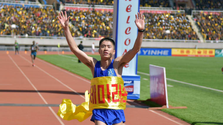 Runner crosses finish line of 30th Mangyongdae Prize International Marathon in Pyongyang, North Korea