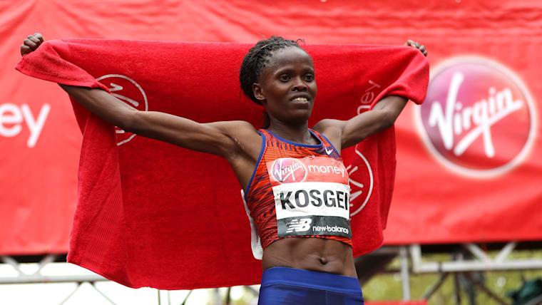 Brigid Kosgei celebrates winning the women's elite race at the 2019 London Marathon