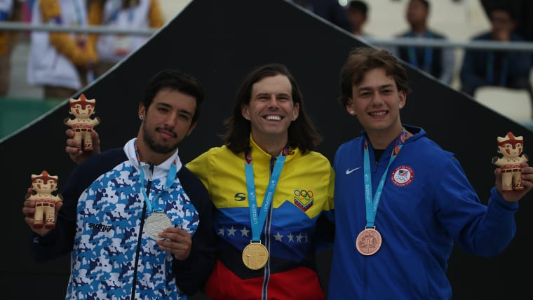 Pan American Games - Lima 2019 - Cycling BMX - Men Freestyle BMX Final - Costa Verde Beach Circuit, Lima, Peru - August 11, 2019. Venezuela's Daniel Dhers celebrates with Argentina's Jose Torres and Justin Dowell of the U.S. on the podium after winning gold, silver and bronze respectively. REUTERS/Pilar Olivares