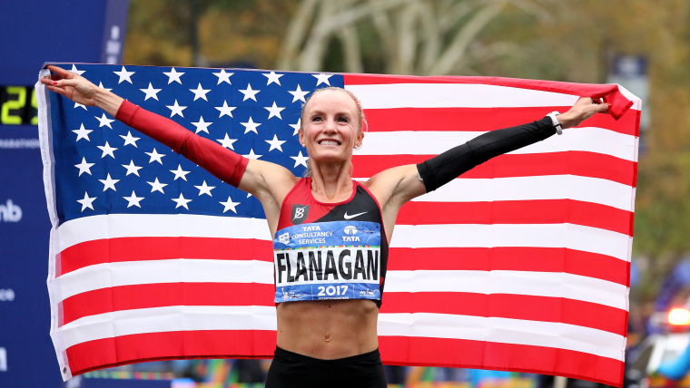 Shalane Flanagan celebrates after winning the 2017 NYC Marathon
