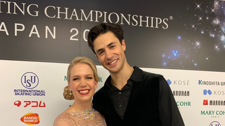 Kaitlyn Weaver and Andrew Poje after their rhythm dance