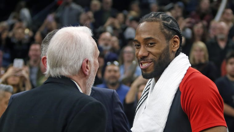 Gregg Popovich speaks with Toronto Raptors' guard Kawhi Leonard