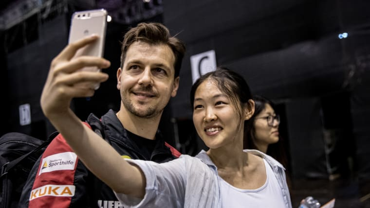Timo Boll poses for a photo with a fan at the 2017 World Table Tennis Championships. (Photo by Maja Hitij/Bongarts/Getty Images)