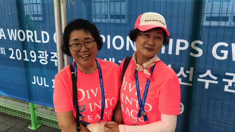 The Gwangju 2019 volunteers are easily recognisable in fluorescent pink T-shirts and jackets