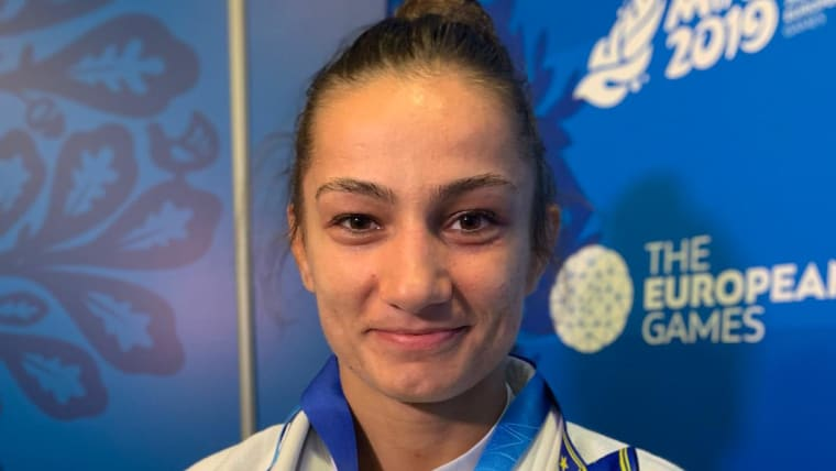 Kosovo's star judoka Majlinda Kelmendi shows off her European Games and European Championship medals. Photo: Olympic Channel