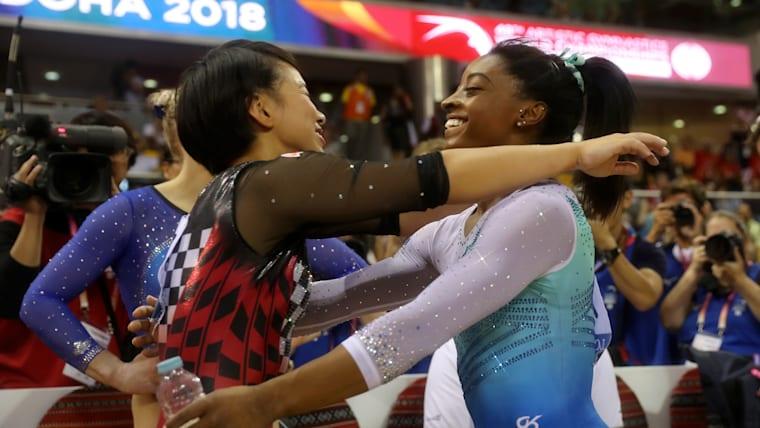 All-around champion Simone Biles embraces runner-up Mai Murakami