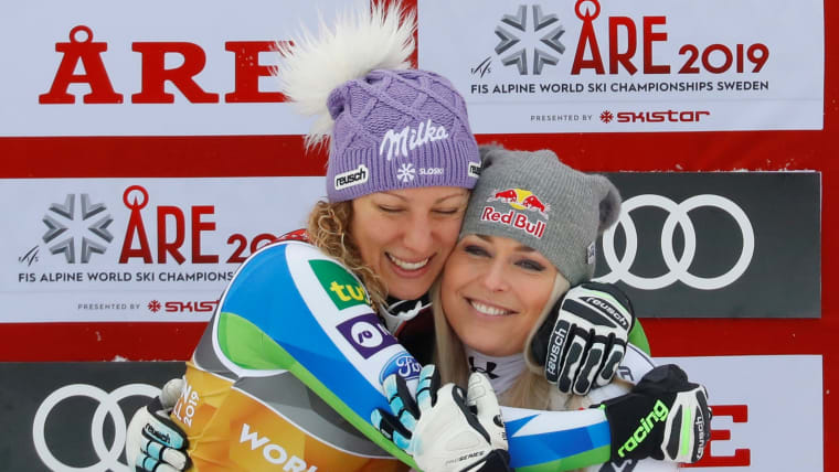 World downhill champion Ilka Stuhec hugs bronze medallist Lindsey Vonn in Are, Sweden