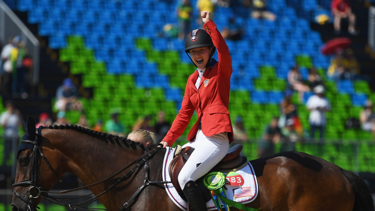 Silver medalist Lucy Davis of United States riding Barron celebrates before the medal ceremony after the Jumping Team competition on Day 12 of the Rio 2016 Olympic Games at the Olympic Equestrian Centre on August 17, 2016 in Rio de Janeiro, Brazil. (Photo by David Ramos/Getty Images)