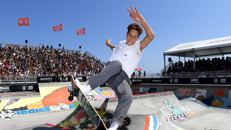 A closeup of male skateboarder Jagger Eaton performing a slide during competition.