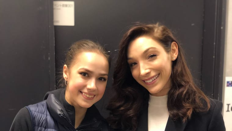 Olympic champions Alina Zagitova, left, and Meryl Davis, right, meet at the World Figure Skating Championships