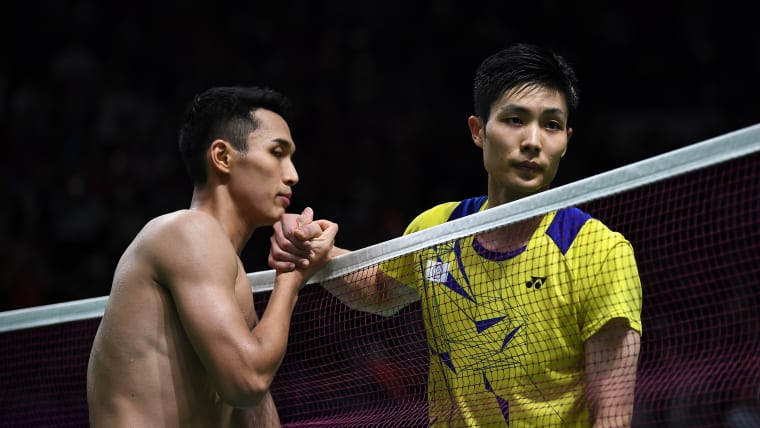 Christie shakes with Chinese Taipei's Chou Tienchen after the final. (Photo by Robertus Pudyanto/Getty Images)