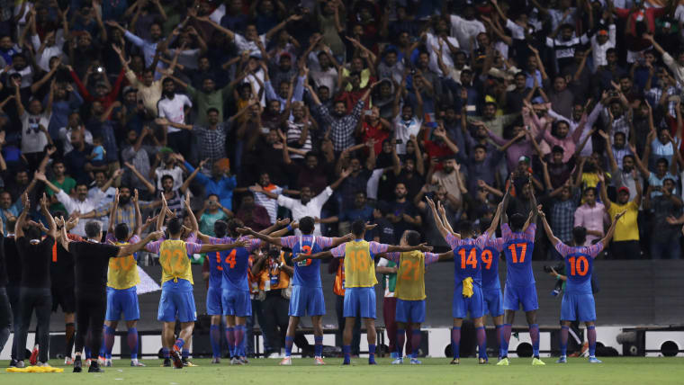 India celebrate with fans after Qatar draw