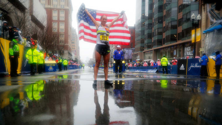 USA's Desiree Linden celebrates Boston Marathon 2018 win in rainy conditions
