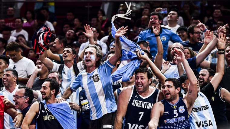 Fans of Argentina celebrate during the semi final match between Argentina and France in Beijing, China.