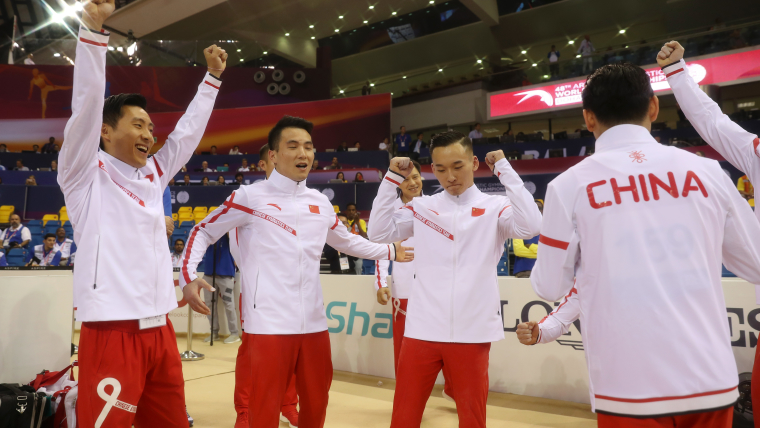 Team China celebrate after winning their first World title in four years