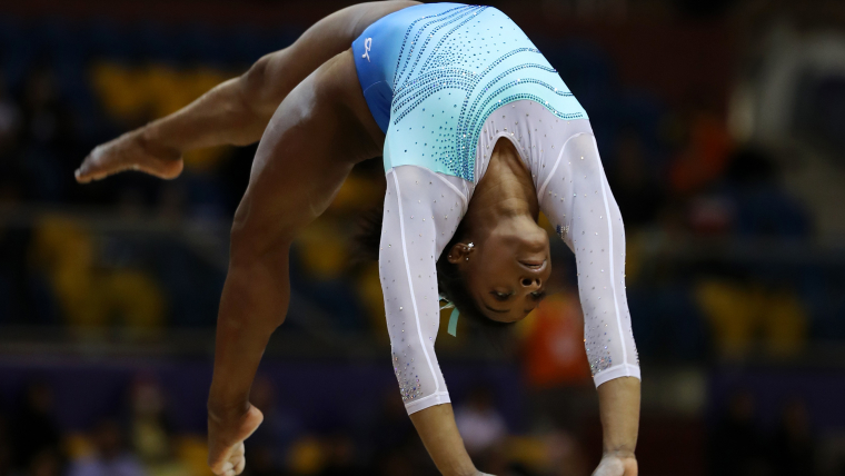 Simone Biles performs on the balance beam during the world all-around final in Doha