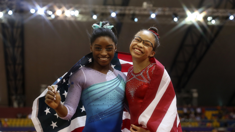 All-around champion Simone Biles and bronze medallist Morgan Hurd pose with the American flag