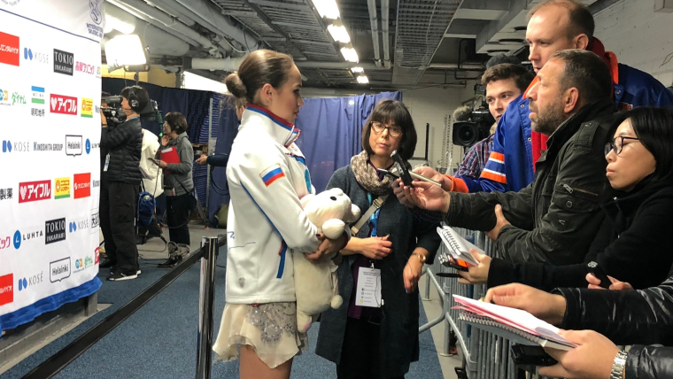 Alina Zagitova speaks to reporters after her short program at the Grand Prix of Helsinki
