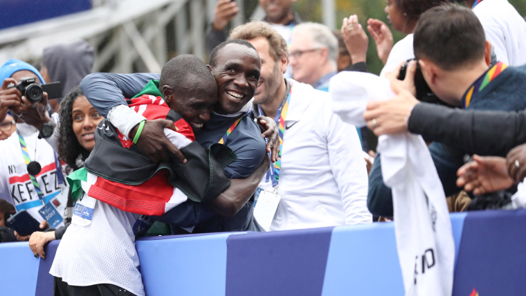 Eliud Kipchoge congratulates Geoffrey Kamworor on his 2017 NYC Marathon success