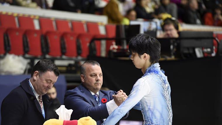 Yuzuru Hanyu with coaches Ghislain Briand and Brian Orser (L)
