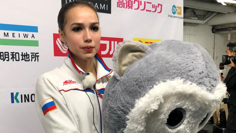 Alina Zagitova receives a giant toy after her free skate at the Grand Prid of Helsinki