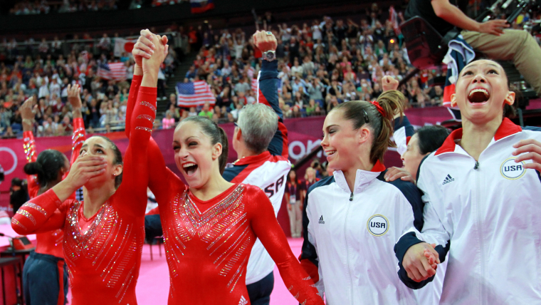 Jordyn Wieber congratulates Aly Raisman (far left) with USA teammates McKayla Maroney and Kyla Ross