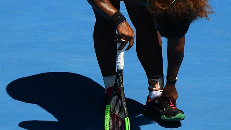 Serena Williams rubs her foot after turning her ankle in the final set against Karolina Pliskova
