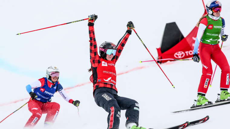 Marielle Thompson (red) celebrates winning the world ski cross title in Solitude, Utah from Fanny Smith (green)