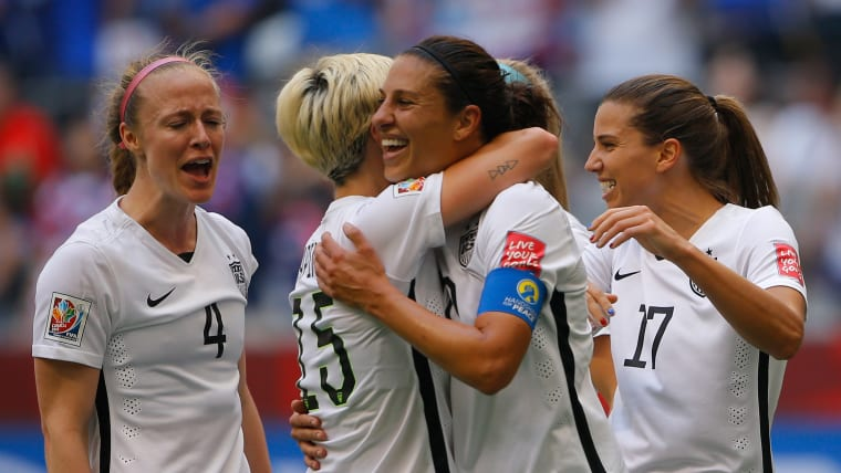 Carli Lloyd congratulated after scoring her third goal in USA's 5-2 win over Japan in the 2015 Women's World Cup Final in Vancouver