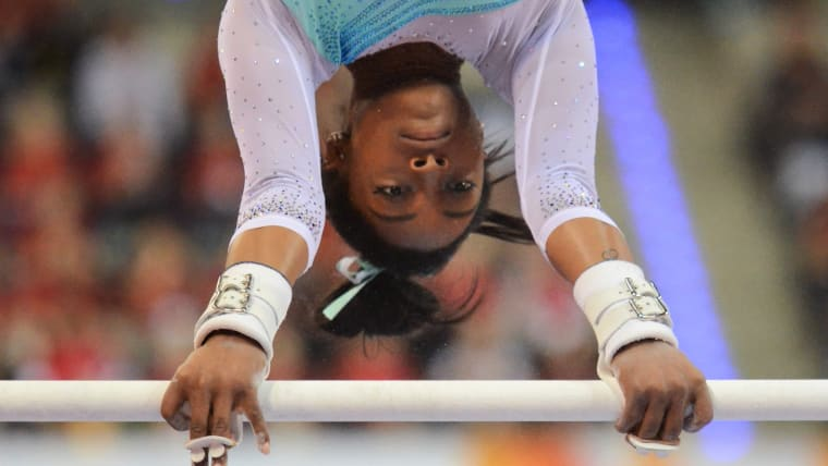 Simone Biles competing on the uneven bars in the All-Around World Cup in Stuttgart