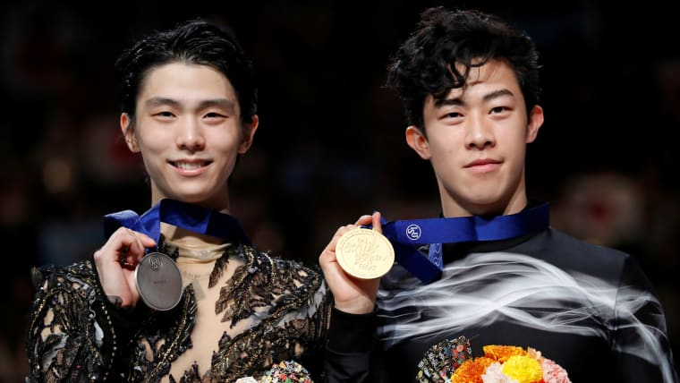 2019 world champion Nathan Chen (R) with silver medallist Yuzuru Hanyu in Saitama