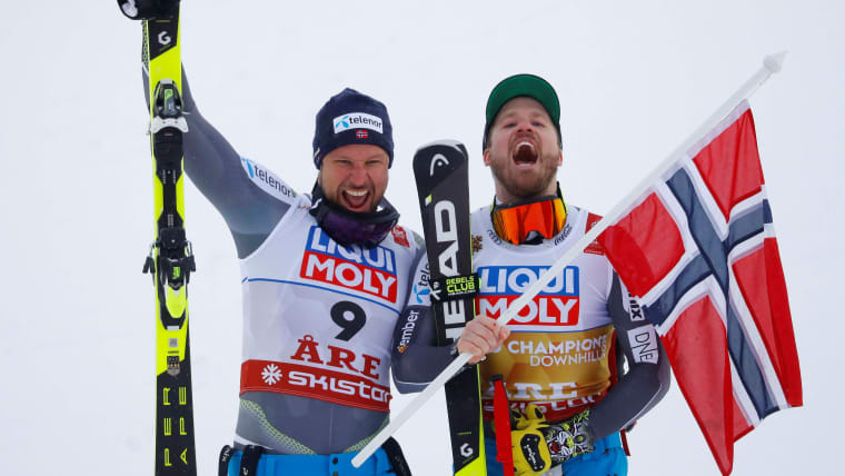 Runner-up Aksel Lund Svindal celebrates with champion Kjetil Jansrud after the World Championship downhill in Are, Sweden