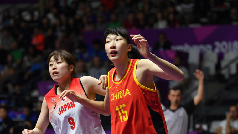 Han Xu (R) playing for China against Japan ahead of the 2018 Asian Games