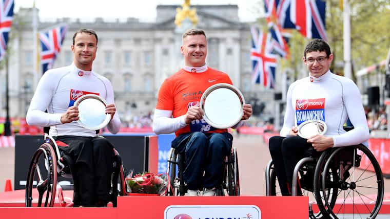 2018 London Marathon wheelchair elite men podium (L-R): runner-up Marcel Hug, winner David Weir, third-placed Daniel Romanchuk