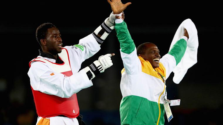 Cisse Sallah Cisse celebrates his Olympic title win with coach Tadjou Attadda