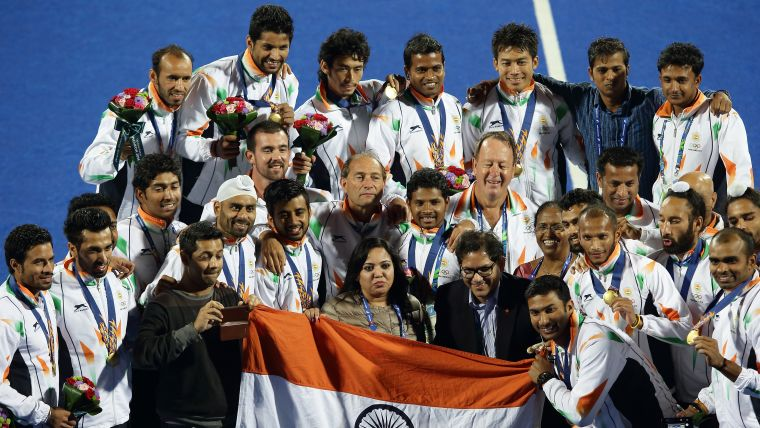 India, coached by Australian Terry Walsh (centre-right), celebrate victory over Pakistan in the final of 2014 Asian Games in Incheon