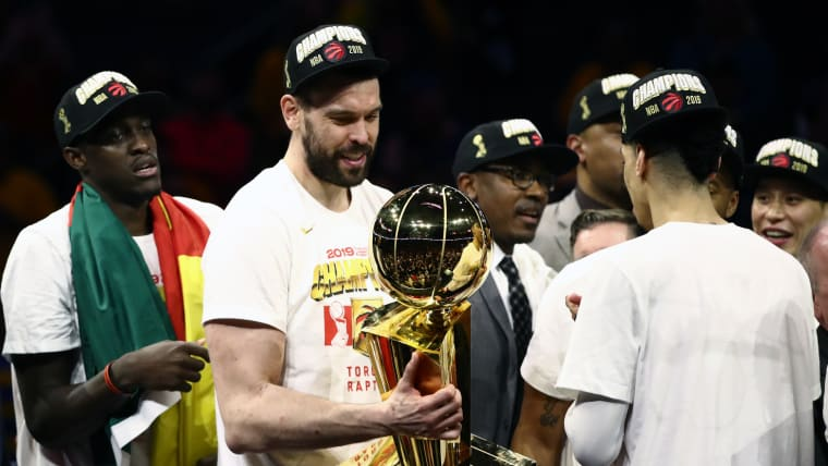 Marc Gasol of the Toronto Raptors holds the NBA Championship trophy
