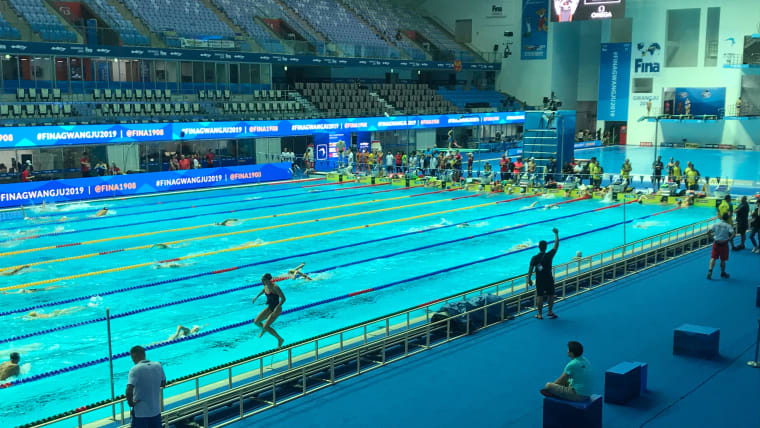 Swimmers practice in the competition pool in Gwangju