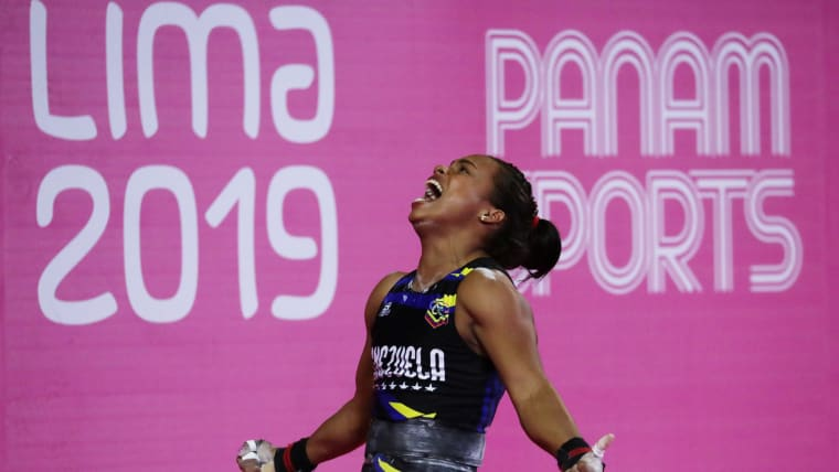 Genesis Rodriguez lets out a roar after beating her own weightlifting record in the Women's 55kg event in the Coliseo Mariscal Caceres, Lima, Peru - July 28, 2019. Venezuela'sREUTERS/Guadalupe Pardo