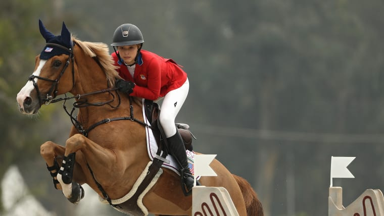 USA's Eve Jobs on Venue D'Fees Des Hazalles competes in the equestrian horse jumping Individual 1st Qualifier on Day 11 at Lima 2019. (Photo by Patrick Smith/Getty Images)