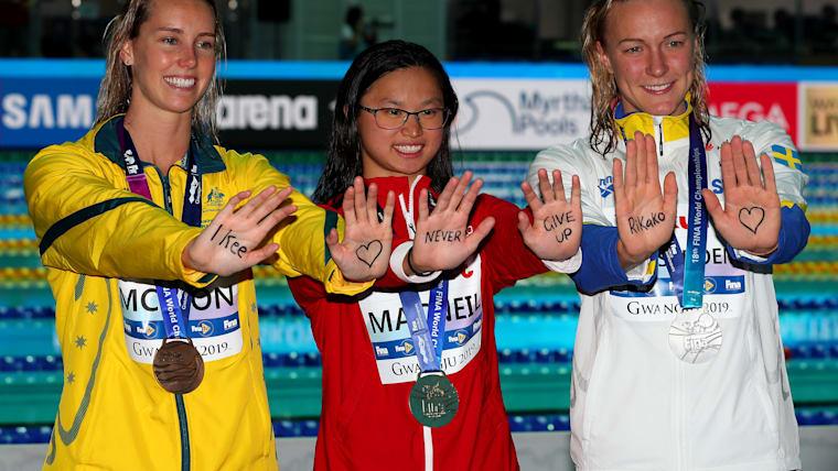 2019 Worlds women's 100m butterfly (L-R): third-placed Emma McKeon, champion Maggie MacNeil, runner-up Sarah Sjostrom
